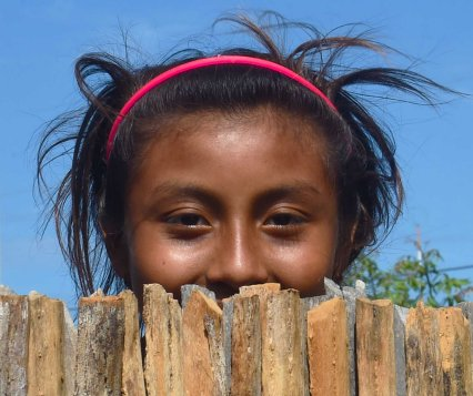 A girl from the Wayuu indigenous etnia at a Christmas event where members of Kiwanis Foundation gave away gifts to Wayuu kids at the Manhanaim Rancheria in Cabo de la Vela, Guajira department, Colombia, on December 23, 2017. Photo by Joaquin Sarmiento